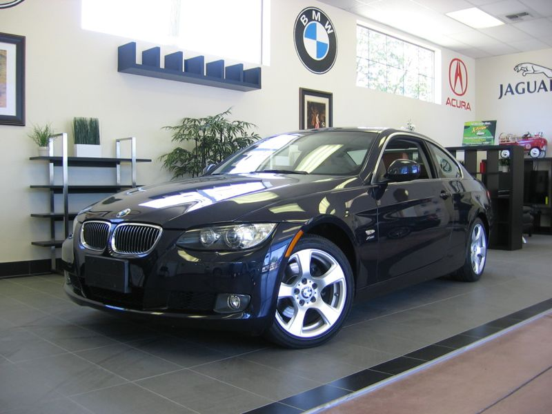 2010 BMW 3-Series 328xi 2D Coupe Automatic Blue Beige This is a one owner BMW 3 Series with heat