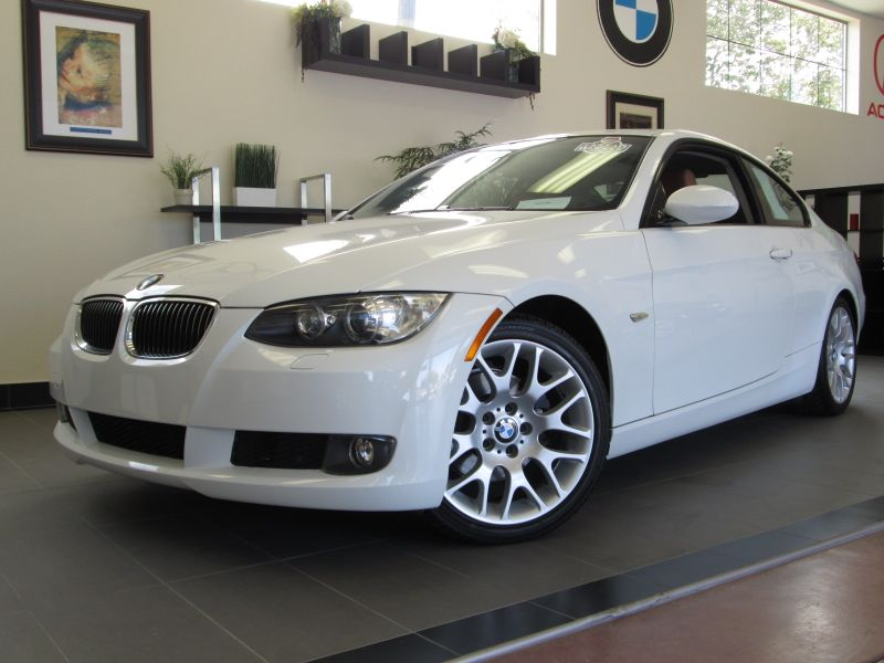 2009 BMW 3-Series 328i 2D Coupe 6 Speed Manual White Beige This is a rare 6 Speed 328ci with Spo