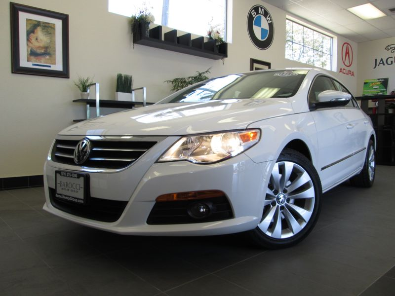 2010 Volkswagen CC Sport 4D Coupe Automatic White Tan This 20 TFSi motor produces an impressive