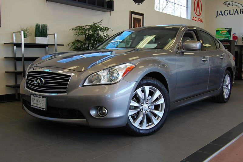 2011 Infiniti M M56 7-Speed Automatic Silver Tan Comes with a ton of great features including re