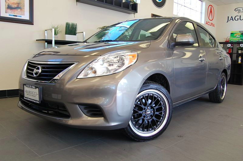 2012 Nissan Versa 16 SV Sedan Automatic Gray Gray This is a great Versa SV with steering wheel