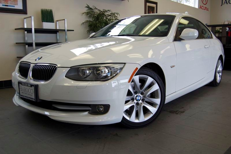 2011 BMW 3 Series 328i 2dr Coupe SULEV Automatic White Black Comes with a clean Carfax and is ju